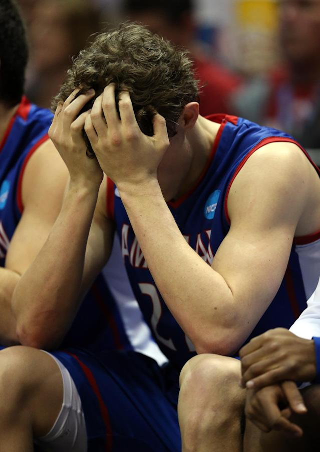 MILWAUKEE, WI - MARCH 20: John Schoof #22 of the American University Eagles reacts on the bench during the second round game of NCAA Basketball Tournament against the Wisconsin Badgers at BMO Harris Bradley Center on March 20, 2014 in Milwaukee, Wisconsin. (Photo by Jonathan Daniel/Getty Images)