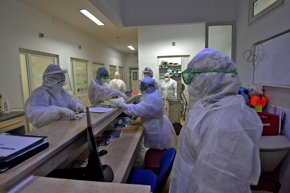 A members of the medical staff prepares to enter a coronavirus room at the intensive care unit of the Ariana Abderrahmen Mami hospital in the city of Ariana near the Tunisian capital Tunis on January 27, 2020, during the coronavirus pandemic crisis. (Photo by FETHI BELAID / AFP) (Photo by FETHI BELAID/AFP via Getty Images)