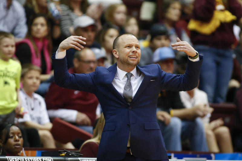 Winthrop head coach Pat Kelsey encourages fans to be loud in the second half of an NCAA college basketball game against Hampton for the Big South tournament championship in Rock Hill, S.C., Sunday, March 8, 2020. (AP Photo/Nell Redmond)