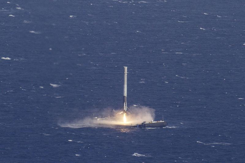 The reusable main-stage booster from the SpaceX Falcon 9 rocket makes a successful landing on a platform in the Atlantic Ocean about 185 miles (300 km) off the coast of Florida April 8, 2016 in this handout photo provided by SpaceX. REUTERS/SpaceX/Handout via Reuters