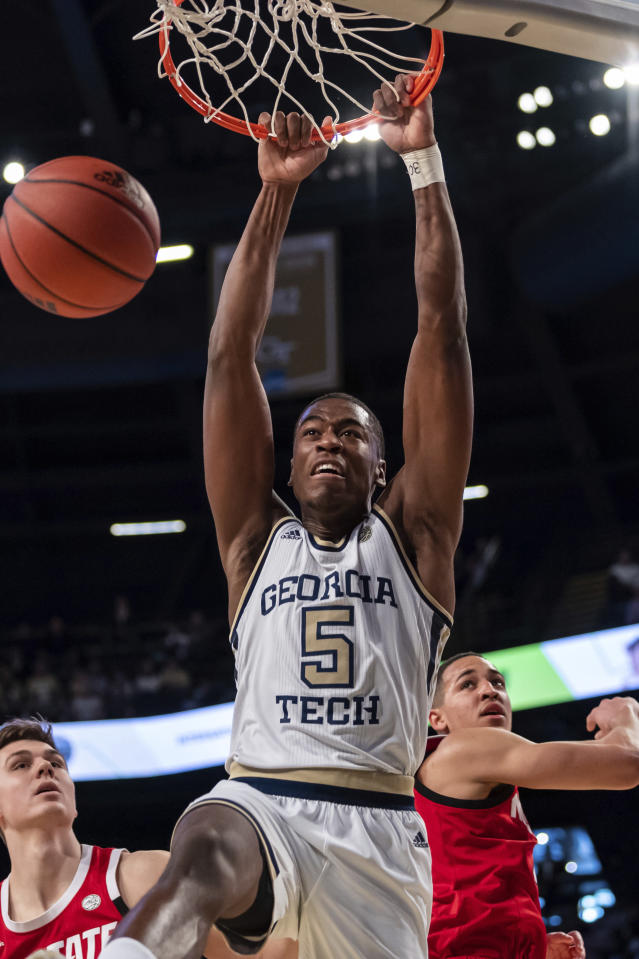Georgia Tech forward Moses Wright (5) dunks in the first half of an NCAA college basketball game against North Carolina State Saturday, Jan. 25, 2020, in Atlanta. (AP Photo/Danny Karnik)