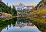 <p><strong>Maroon Lake</strong>, near Aspen, Colorado, is famous for its reflections of the Maroon Bells mountains. Though the most photographed place in Colorado, this small lake can only be reached by foot. </p>