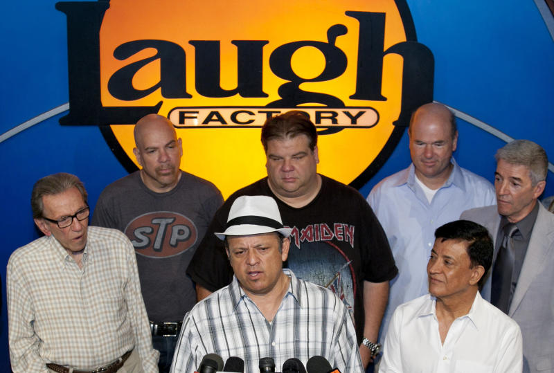 Comedian Paul Rodriguez, at podium, expresses the comedians support for Jerry Lewis to be reinstated as host of the annual Muscular Dystrophy Association, MDA Telethon, at the Laugh Factory in Los Angeles, Friday, Aug. 5, 2011.  Comedians include from left in front row: Norm Crosby, Rodriguez, Jamie Masada. In the background, from left: Jason Stuart, Angelo Tsarouchas, Larry Miller and Tom Dreesen. (AP Photo/Damian Dovarganes)