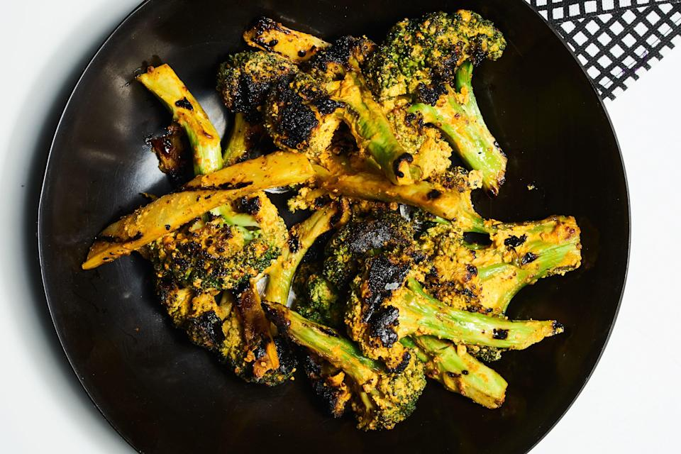 """If you've never grilled broccoli, you've <em>got</em> to try it. The broccoli is slathered in a spiced yogurt sauce and when the broccoli hits the grill, the spicy flavor comes alive. <a href=""""https://www.epicurious.com/recipes/food/views/grilled-mustard-broccoli?mbid=synd_yahoo_rss"""" rel=""""nofollow noopener"""" target=""""_blank"""" data-ylk=""""slk:See recipe."""" class=""""link rapid-noclick-resp"""">See recipe.</a>"""