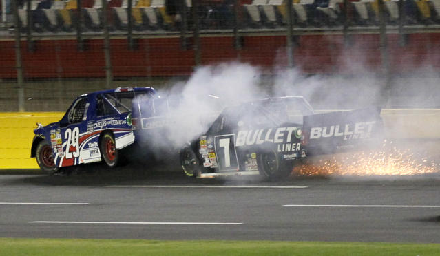 Ryan Blaney (29) is hit from behind by Brian Ickler (7) during the NASCAR Trucks series auto race at Charlotte Motor Speedway in Concord, N.C., Friday, May 16, 2014. (AP Photo/Terry Renna)