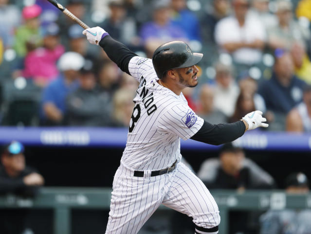 Colorado Rockies' Nolan Arenado follows the flight of his two-run home run off Miami Marlins starting pitcher Caleb Smith in the first inning of a baseball game Sunday, June 24, 2018, in Denver. (AP Photo/David Zalubowski)