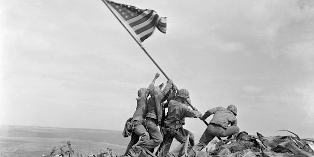 In this February 23, 1945 file photo, US Marines of the 28th Regiment, 5th Division, raise the American flag atop Mt. Suribachi, Iwo Jima, Japan. AP Photo/Joe Rosenthal