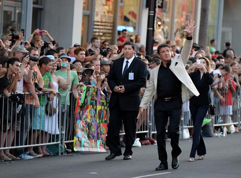"""Actor Sylvester Stallone greets fans as he attends the premiere of """"The Expendables 3' at the TCL Chinese Theatre on August 11, 2014 in Hollywood, California (AFP Photo/Mark Ralston)"""