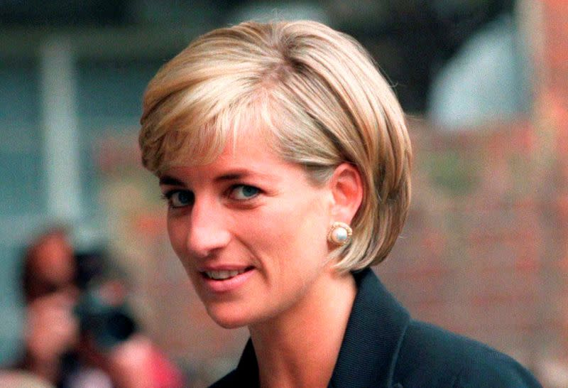 FILE PHOTO: Princess Diana arrives at the Royal Geographical Society in London