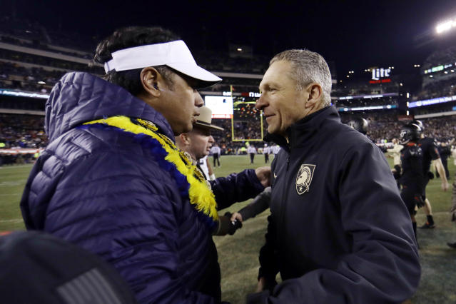 FIEL - In this Dec. 8, 2018, file photo, Army head coach Jeff Monken, right, greets Navy head coach Ken Niumatalolo after an NCAA college football game in Philadelphia. The 120th Army-Navy game is set for Saturday in Philadelphia. Army is trying to win its fourth straight game in the series. (AP Photo/Matt Slocum, File)
