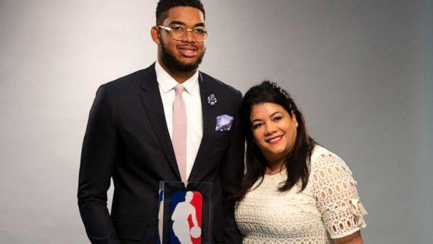 PHOTO: Timberwolves center Karl-Anthony Towns with his mother Jacqueline Cruz, as he had his official pictures taken by team photographer David Sherman after being named NBA Rookie of the Year in 2016. (Brian Peterson/Star Tribune via Getty Images)