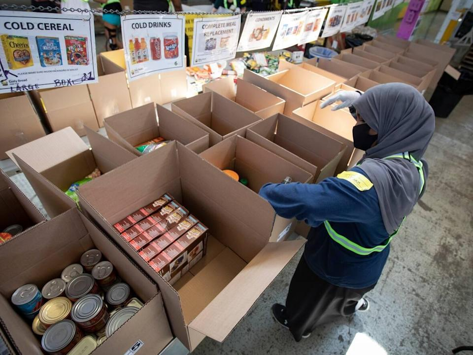 The Caldwell Family Centre says it's seen an unprecedented increase in the need for food this year.  Since January, the number of meals they've served increased 178%, and the number of grocery food boxes given out increased 188%. (Evan Mitsui/CBC - image credit)