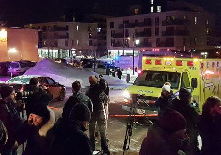 An ambulance is parked at the scene of a fatal shooting at the Quebec Islamic Cultural Centre in Quebec City. REUTERS/Mathieu Belanger