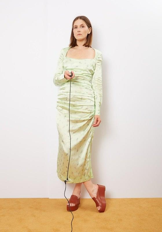 "<br><br><strong>Ganni</strong> Patina Green Long Sleeve Silk Stretch Satin Dress, $, available at <a href=""https://go.skimresources.com/?id=30283X879131&url=https%3A%2F%2Fshoplepoint.com%2Fganni-patina-green-long-sleeve-silk-stretch-satin-dress%2F"" rel=""nofollow noopener"" target=""_blank"" data-ylk=""slk:Le Point"" class=""link rapid-noclick-resp"">Le Point</a>"