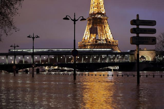 <p>A view shows the flooded banks of the Seine River and the Eiffel Tower after days of rainy weather in Paris, France, Jan. 23, 2018. (Photo: Gonzalo Fuentes/Rueters) </p>