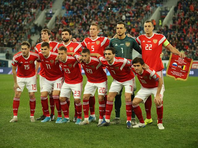 The Russian team pictured in their 'old' Adidas kit: Getty