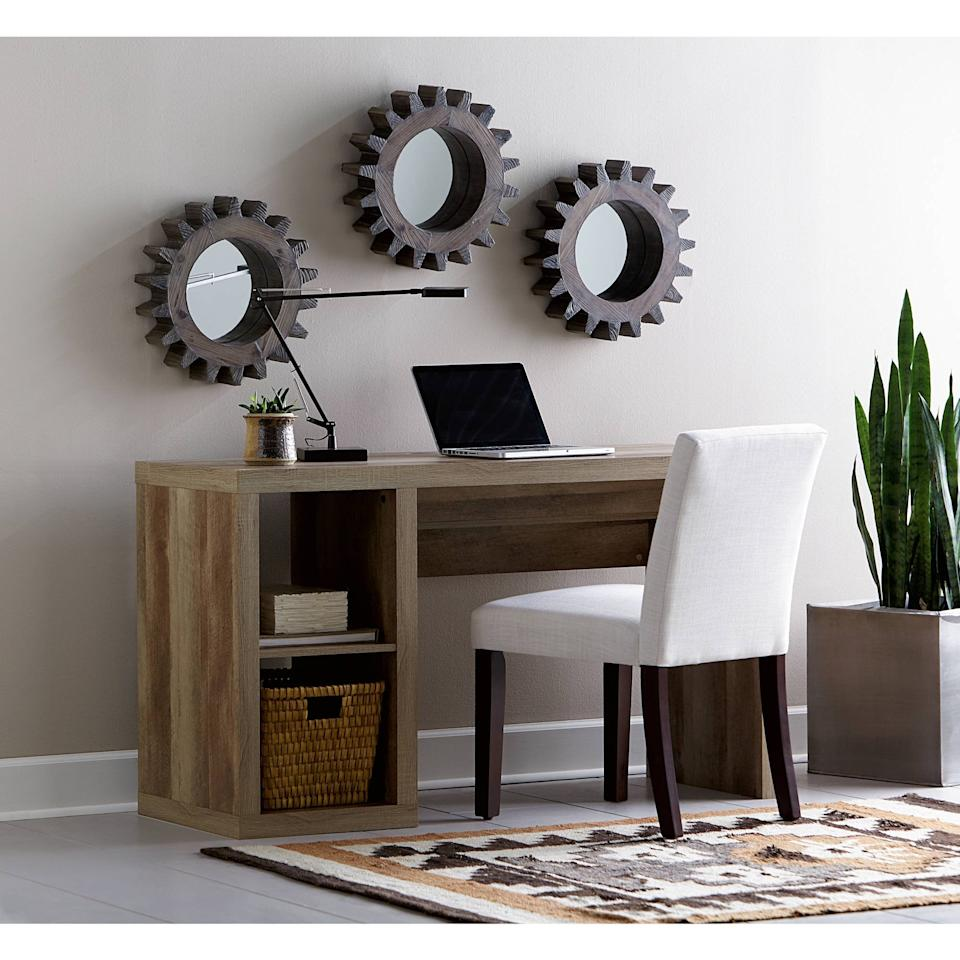 """<p>We love that this <a href=""""https://www.popsugar.com/buy/Better-Homes-amp-Gardens-Cube-Storage-Organizer-Office-Desk-481130?p_name=Better%20Homes%20%26amp%3B%20Gardens%20Cube%20Storage%20Organizer%20Office%20Desk&retailer=walmart.com&pid=481130&price=100&evar1=casa%3Aus&evar9=46509006&evar98=https%3A%2F%2Fwww.popsugar.com%2Fhome%2Fphoto-gallery%2F46509006%2Fimage%2F46509011%2FBetter-Homes-Gardens-Cube-Storage-Organizer-Office-Desk&list1=sales%2Cfurniture%2Cwalmart%2Csale%20shopping%2Chome%20shopping&prop13=mobile&pdata=1"""" rel=""""nofollow"""" data-shoppable-link=""""1"""" target=""""_blank"""" class=""""ga-track"""" data-ga-category=""""Related"""" data-ga-label=""""https://www.walmart.com/ip/Better-Homes-Gardens-Cube-Storage-Organizer-Office-Desk-Multiple-Finishes/49404218"""" data-ga-action=""""In-Line Links"""">Better Homes &amp; Gardens Cube Storage Organizer Office Desk</a> ($100, originally $149) has two shelves for extra storage.</p>"""