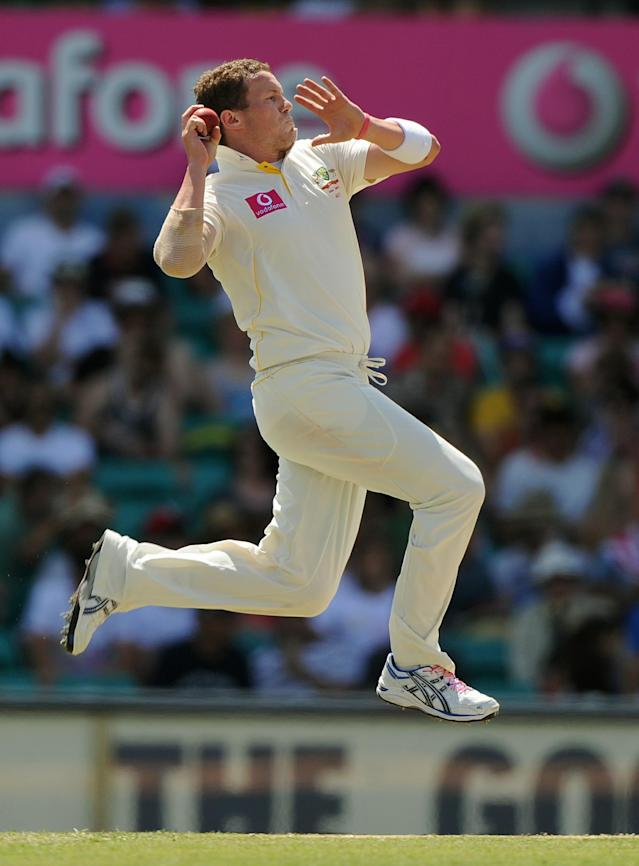 Australia's Peter Siddle runs in to bowl on day four of the fifth Ashes cricket Test against Australia at the Sydney Cricket Ground on January 6, 2011. England were 609 for nine as play continues. IMAGE STRICTLY RESTRICTED TO EDITORIAL USE - STRICTLY NO COMMERCIAL USE AFP PHOTO / Greg WOOD (Photo credit should read GREG WOOD/AFP/Getty Images)