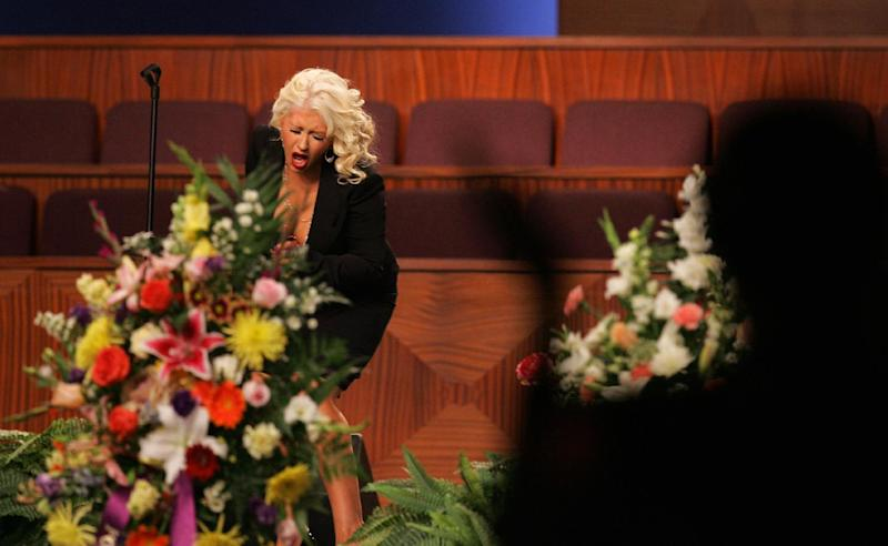 "Christina Aguilera performs at the funeral of singer Etta James, Saturday, Jan. 28, 2012, at Greater Bethany Community Church City of Refuge in Gardena, Calif. James died last Friday at age 73 after battling leukemia and other ailments, including dementia. She was most famous for her classic ""At Last,"" but over her decades-long career, she became revered for her passionate singing voice. (AP Photo/Ringo H.W. Chiu)"