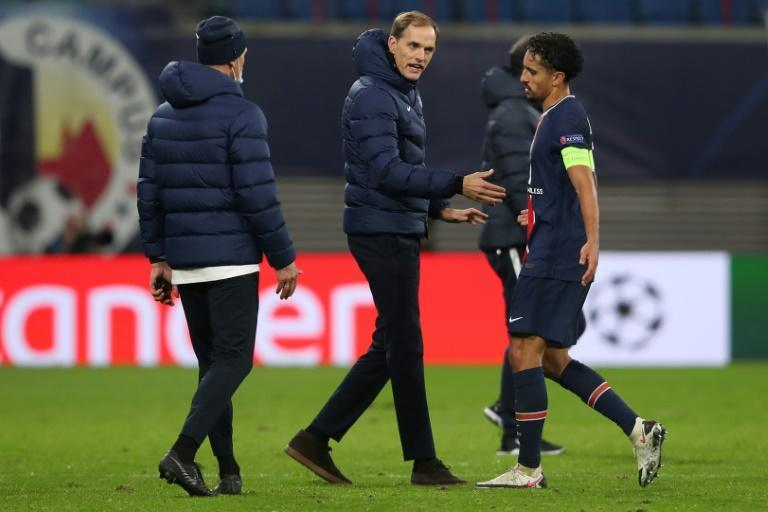 PSG coach Thomas Tuchel with his captain Marquinhos at the end of their defeat in Leipzig
