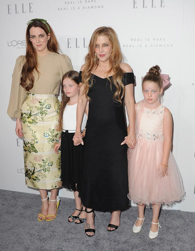 Lisa Marie Presley briefly lost custody of her her twin daughters, Finley and Harper, but she was with them as well as older daughter Riley Keough at an <em>Elle</em> event on Oct. 16, 2017. (Photo: Getty Images)