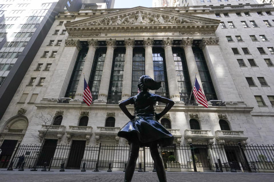 FILE - In this photo file from March 23, 2021, the statue of the Fearless Girl stands in front of the New York Stock Exchange in the Financial District of New York.  Stocks opened significantly higher on Wall Street, starting strongly in June, when traders returned from the celebration of Remembrance Day in the United States (AP Photo / Mary Altaffer, File)