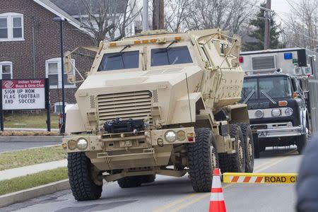 A police armored vehicle is seen near a home in a suburb of Philadelphia where a suspect in five killings was believed to be barricaded in Souderton, Pennsylvania, December 15, 2014. REUTERS/Brad Larrison