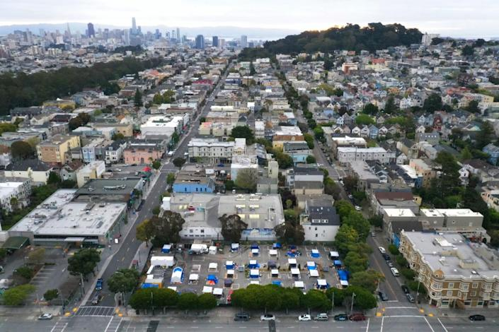 An aerial view of San Francisco shows a block with tents