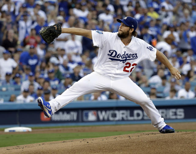 FILE - In this Oct. 28, 2018, file photo, Los Angeles Dodgers pitcher Clayton Kershaw winds up during the first inning in Game 5 of the World Series baseball game against the Boston Red Sox, in Los Angeles. Kershaw, one of the game's elite pitchers, anchors a deep rotation that is key to the team's continued success. (AP Photo/David J. Phillip, File)