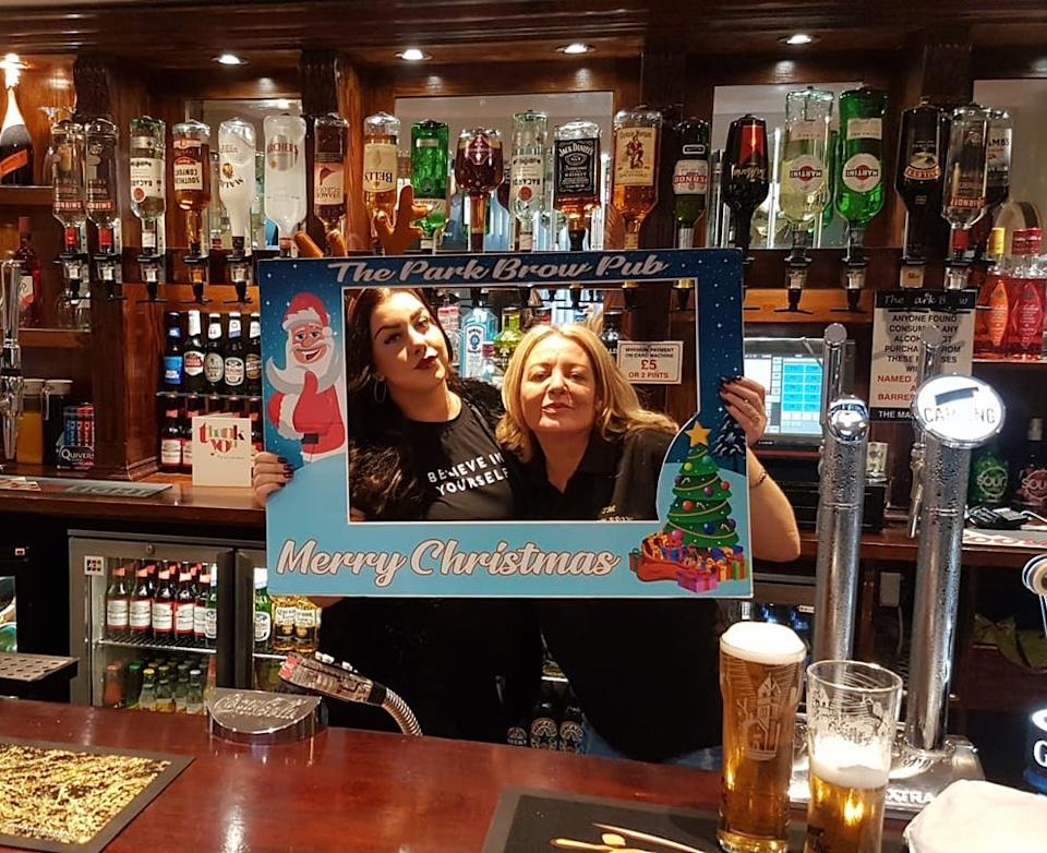 Pub manager Tricia Butler, right, and former staff member Abby Blair, left, during a previous festive season at the Park Brow pub in Kirkby. Photo: The Park Brow