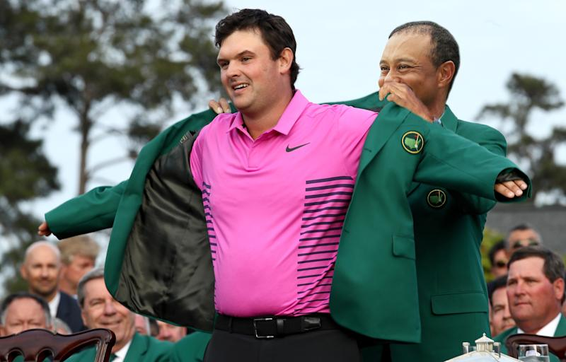 AUGUSTA, GA - APRIL 08: Patrick Reed of the United States is presented with the green jacket by Sergio Garcia of Spain during the green jacket ceremony after winning the 2018 Masters Tournament at Augusta National Golf Club on April 8, 2018 in Augusta, Georgia. (Photo by Jamie Squire/Getty Images)
