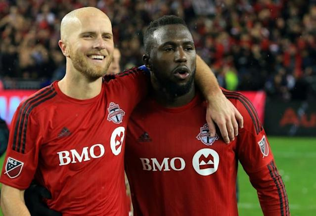 Toronto FC captain Michael Bradley, seen here with teammate Jozy Altidore, will miss up to four months of Major League Soccer action after ankle surgery, the club says (AFP Photo/Vaughn Ridley)