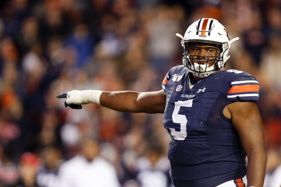 FILE - In this Saturday, Nov. 16, 2019, file photo, Auburn defensive tackle Derrick Brown (5) lines up against Georgia during the second half of an NCAA college football game in Auburn, Ala. Brown has been a play making, blockbusting force for No. 16 Auburn heading into the Iron Bowl. (AP Photo/Butch Dill, File)