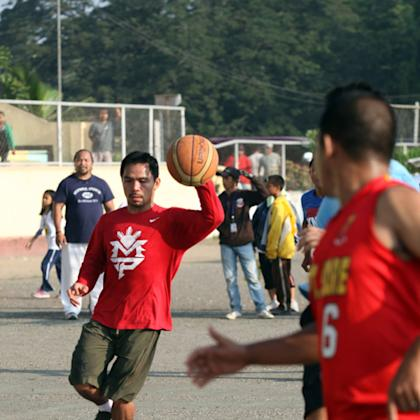 Manny Pacquiao dribbles as he plays basketball after a training session in 2012. (Getty)