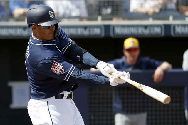 San Diego Padres' Manny Machado hits a two-run home run against the Milwaukee Brewers during the first inning of a spring training baseball game, Wednesday, March 20, 2019, in Peoria, Ariz. (AP Photo/Matt York)