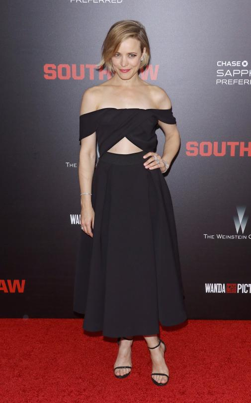 """<p>Stars continue to embrace the off-the-shoulder trend on the red carpet, but Rachel McAdams brought new elegance to the erogenous zone du jour at the New York premiere of 'Southpaw' on Monday night. The actress, who <a href=""""https://www.yahoo.com/style/rachel-mcadams-interview-southpaw-rachel-mcadams-124327258938.html"""" target=""""_blank"""">recently told Yahoo Style</a> that it took her two and a half hours to transform into her character Maureen every single day, wore a full-skirted look from Self-Portrait, one of Hollywood's current favorite brands. With a triangle cut-out at the waist and simple strappy sandals, she looked both comfortable and glamourous. Stars, they're not just like us!</p>"""