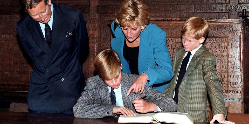 <p>Prince William follows Eton tradition by signing a book before starting at the school as the rest of his family looks on. </p>