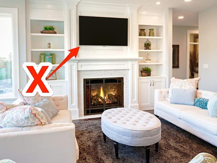 tv above fireplace in living room