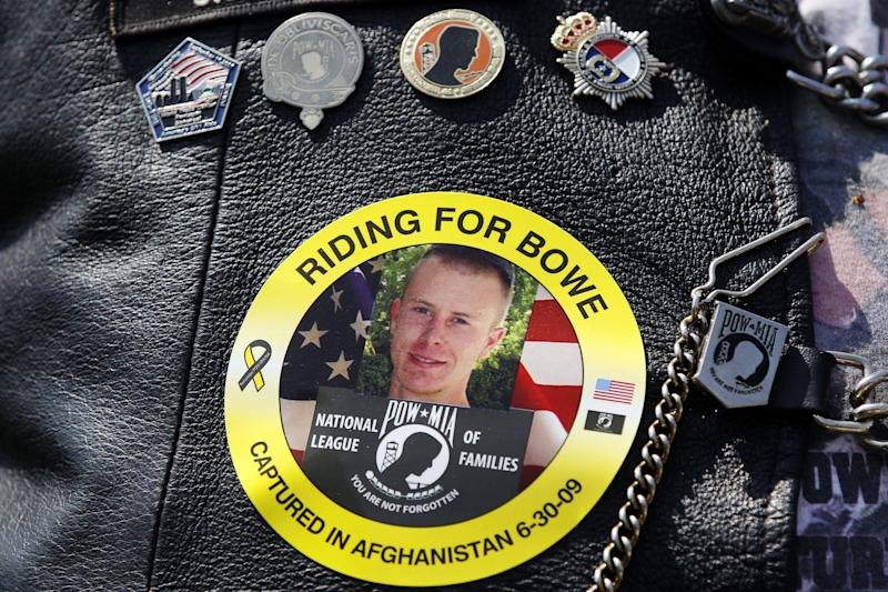 FILE -- The image of Army Sgt. Bowe Bergdahl of Hailey, Idaho, who is being held captive in Afghanistan, is worn by an audience member as Bergdahl's father Bob, not pictured, speaks at the annual Rolling Thunder rally for POW/MIA awareness, in Washington, Sunday, May 27, 2012. A Taliban spokesman, Shaheen Suhail, in an exclusive telephone interview with The Associated Press from the newly opened Taliban offices in Doha, Qatar, said Thursday, that they are ready to hand over U.S. Army Sgt. Bowe Bergdahl held captive since 2009 in exchange for five of their senior operatives being held at the Guantanamo Bay prison. The U.S. is scrambling to save talks with the Taliban after angry complaints from Afghanistan President Hamid Karzai. (AP Photo/Charles Dharapak, File)
