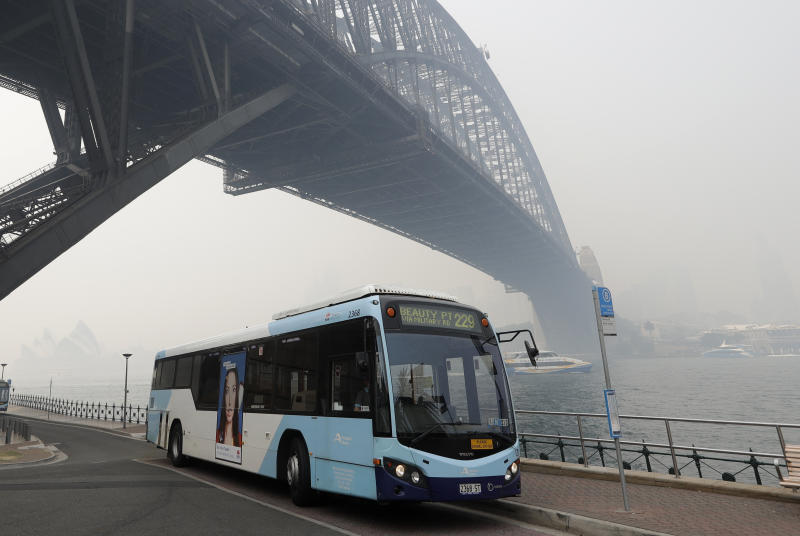 Thick smoke from wildfires shroud the Harbour Bridge in Sydney, Australia, Tuesday, Dec. 10, 2019. Hot dry conditions have brought an early start to the fire season. (AP Photo/Rick Rycroft)