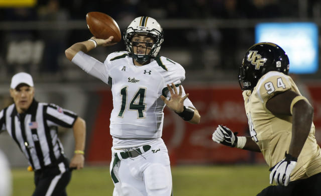 South Florida quarterback Mike White (14) drops to throw under pressure from Central Florida defensive lineman Demetris Anderson (94) during the first half of an NCAA college football game on Friday, Nov. 29, 2013, in Orlando, Fla. (AP Photo/Reinhold Matay