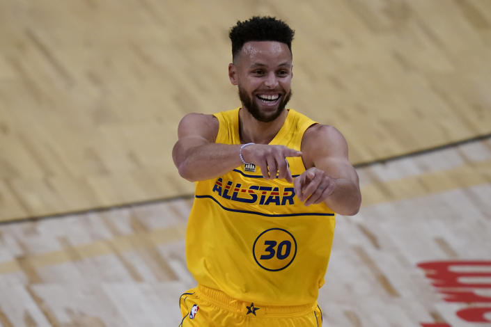Golden State Warriors guard Stephen Curry celebrates after scoring during the first half of basketball's NBA All-Star Game in Atlanta, Sunday, March 7, 2021. (AP Photo/Brynn Anderson)