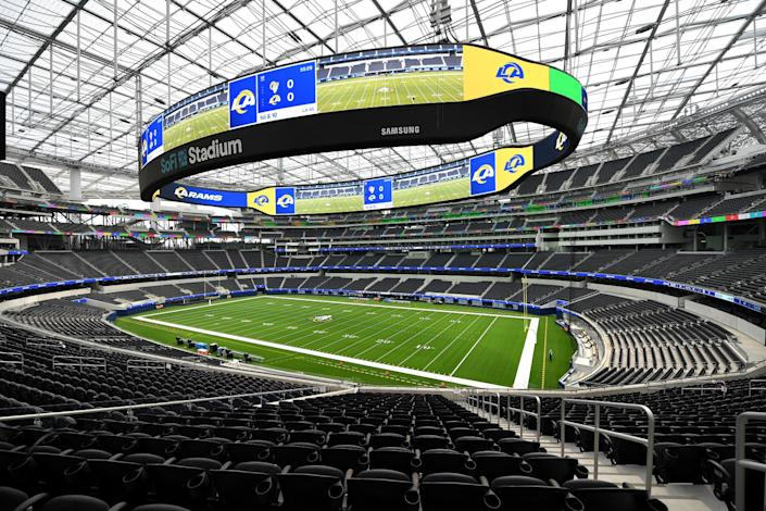 """The playing field and overhanging electronic display, dubbed Oculus, at SoFi Stadium in Inglewood. <span class=""""copyright"""">(Wally Skalij / Los Angeles Times)</span>"""