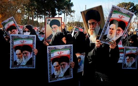 Pro-government demonstrators hold posters of Iran's supreme leader, Ayatollah Ali Khamenei - Credit: MOHAMMAD ALI MARIZAD/AFP/Getty Images