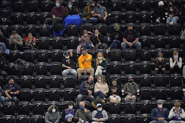 Utah Jazz fans watch during the second half of the team's NBA basketball game against the Phoenix Suns on Thursday, Dec. 31, 2020, in Salt Lake City. (AP Photo/Rick Bowmer)