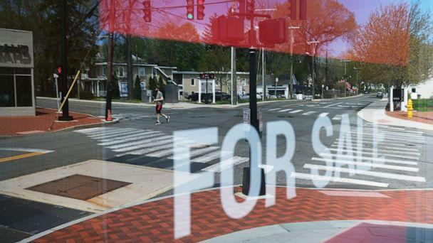 PHOTO: A main shopping street of closed stores in an affluent community remains mostly empty of pedestrians in Westport, Connecticut, on May 5, 2020. (Spencer Platt/Getty Images)