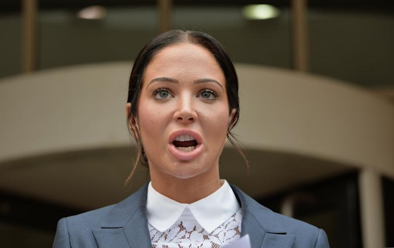 Tulisa Contostavlos makes a statement to the waiting media as she leaves Stratford Magistrates Court in London where she was found guilty of hitting Savvas Morgan during an altercation at V-Festival in Essex.