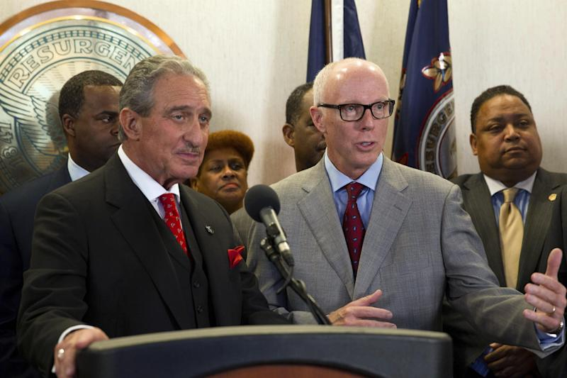 Atlanta Falcons owner Arthur Blank, left, and Falcons President and CEO Rich McKay speak during a news conference Thursday, March 7, 2013, at which government and team officials announced that financing terms have been reached for the Falcons' proposal to build a new $1 billion stadium, keeping the NFL football team's home games in the city's downtown.  (AP Photo/Todd Kirkland)