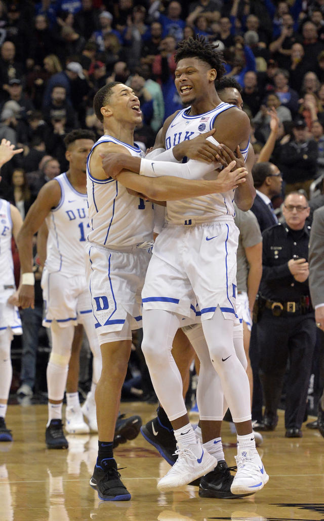 Duke guard Jordan Goldwire, left, and forward Cam Reddish celebrate following the team's 71-69 victory over Louisville in an NCAA college basketball game in Louisville, Ky., Tuesday, Feb. 12, 2019. (AP Photo/Timothy D. Easley)