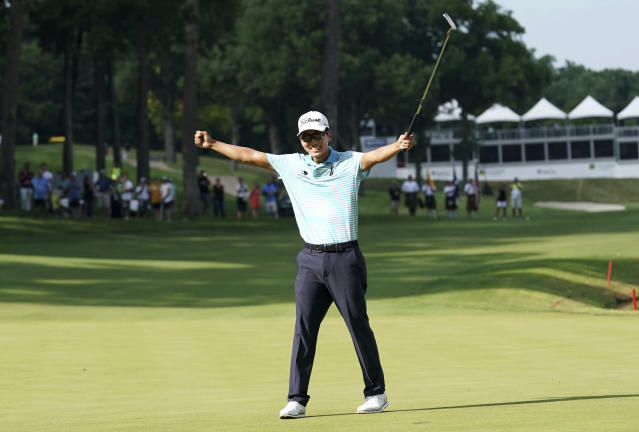 FILE - In this July 15, 2018, file photo, Michael Kim celebrates after winning the John Deere Classic golf tournament in Silvis, Ill. Kim had missed six out of seven cuts and changed coaches when he showed up at the John Deere Classic last year. He broke the tournament record at 27-under 257 and won by eight shots, matching Dustin Johnson and Francesco Molinari for the largest victory margin of the season. And then it was as if the week never happened. (AP Photo/Charlie Neibergall, File)